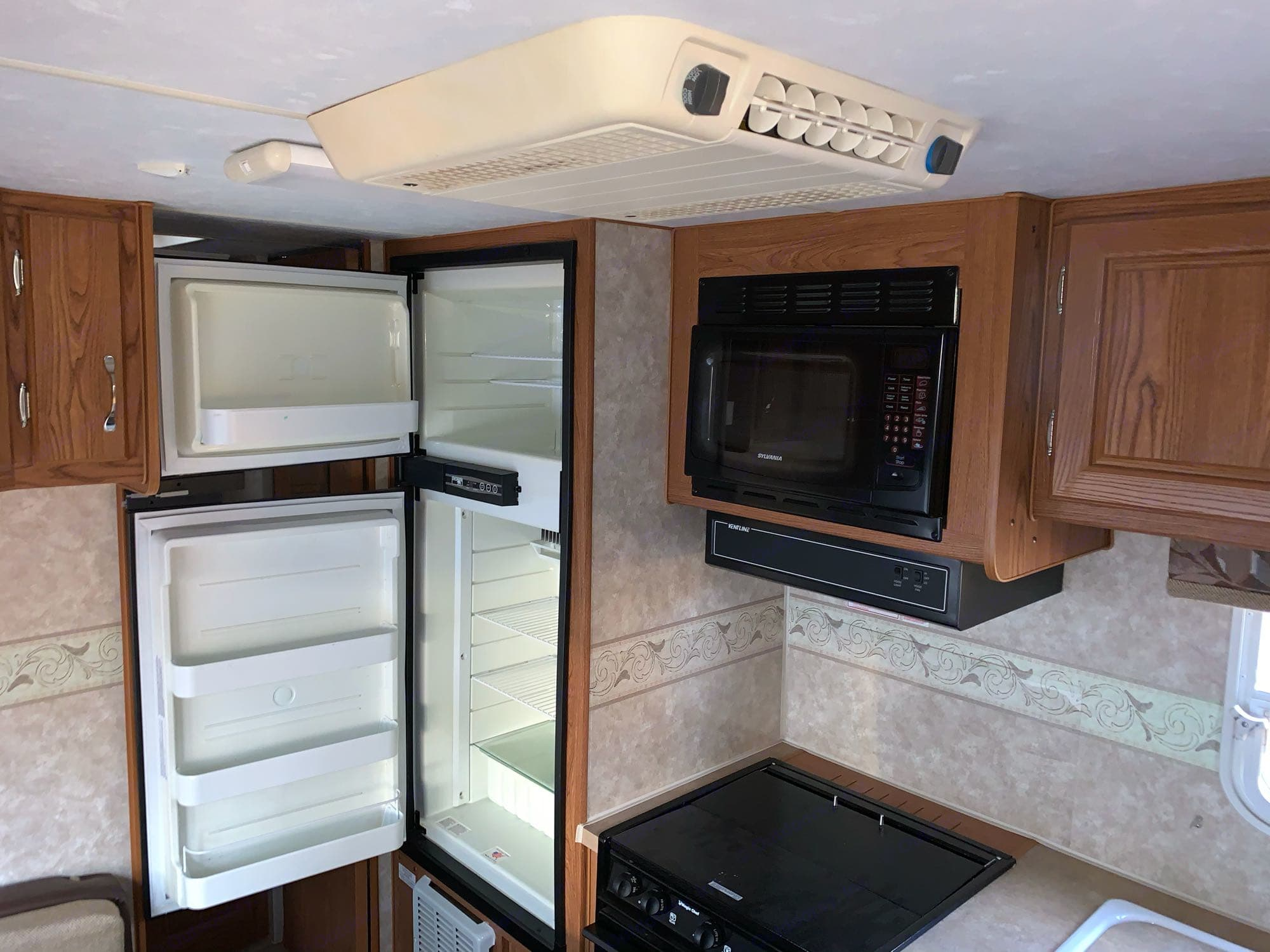microwave, stove, frig and freezer. AC as well. Northwood Mfg Nash 2009