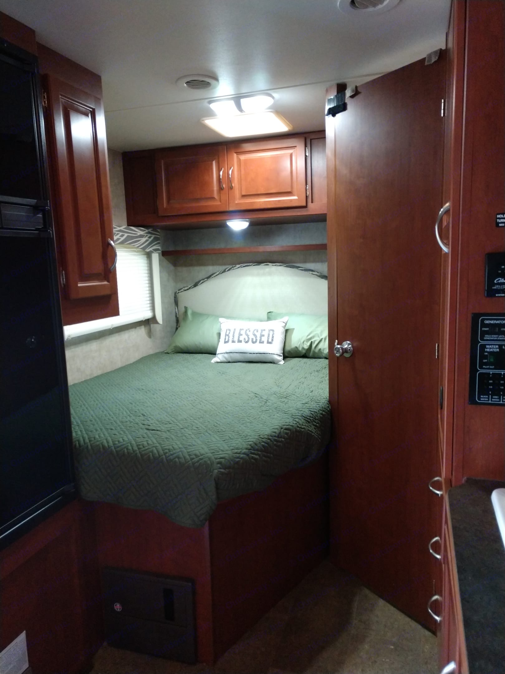 Master sleeping area.  This is a RV queen bed.  It comes with all the bedding, or you can bring your own.  Large storage area above the headboard.. Itasca Spirit 2014