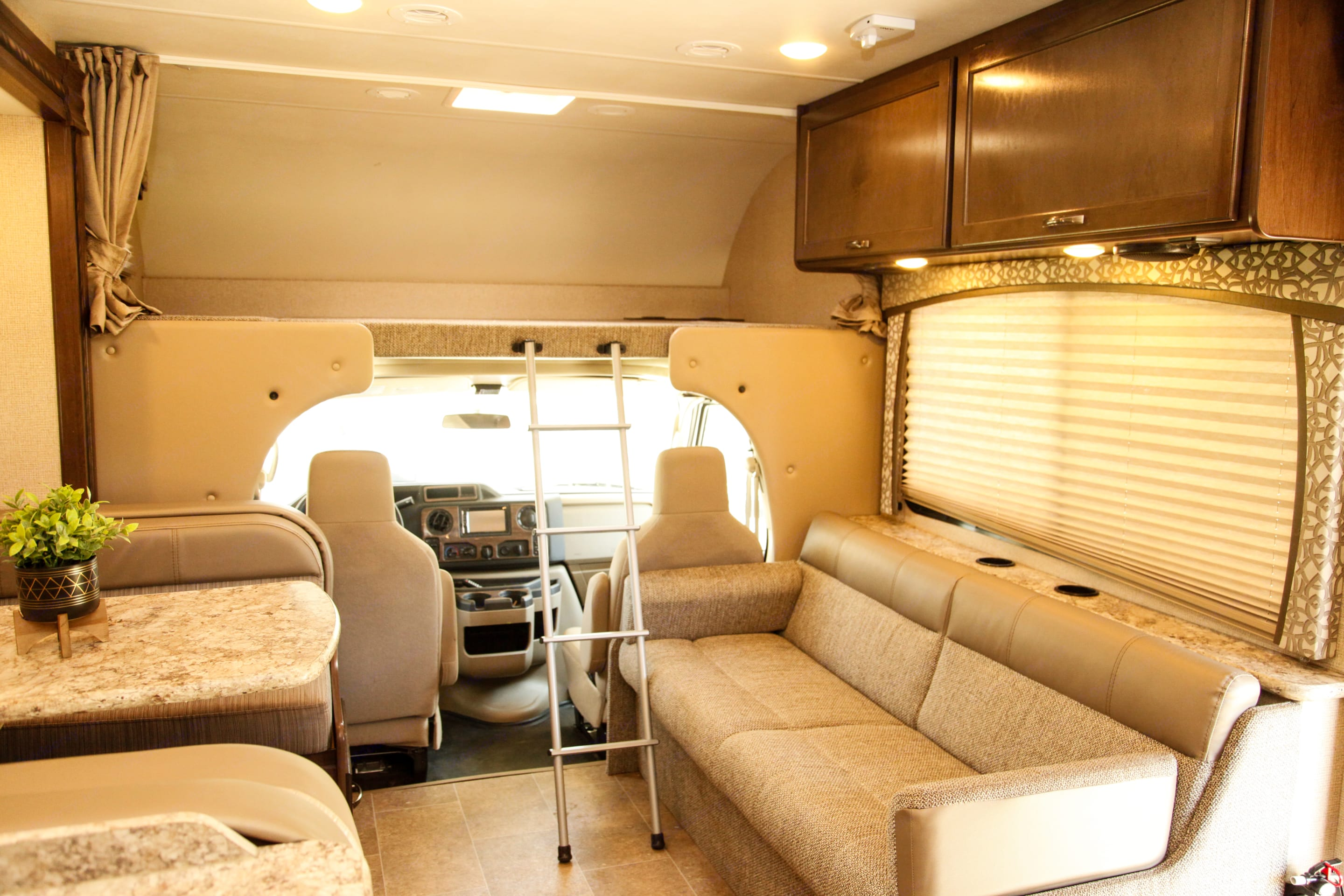 Couch turns in to a bed  Kitchen table turns into a bed Overhead bunk great for 2 adults or teens. Thor Motor Coach Chateau 2017