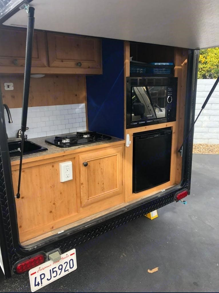 Compact complete kitchenet. Sink, Stove, Microwave, Small Fridge, Storage. . Sunset Park & Rv Sunray 109 2019
