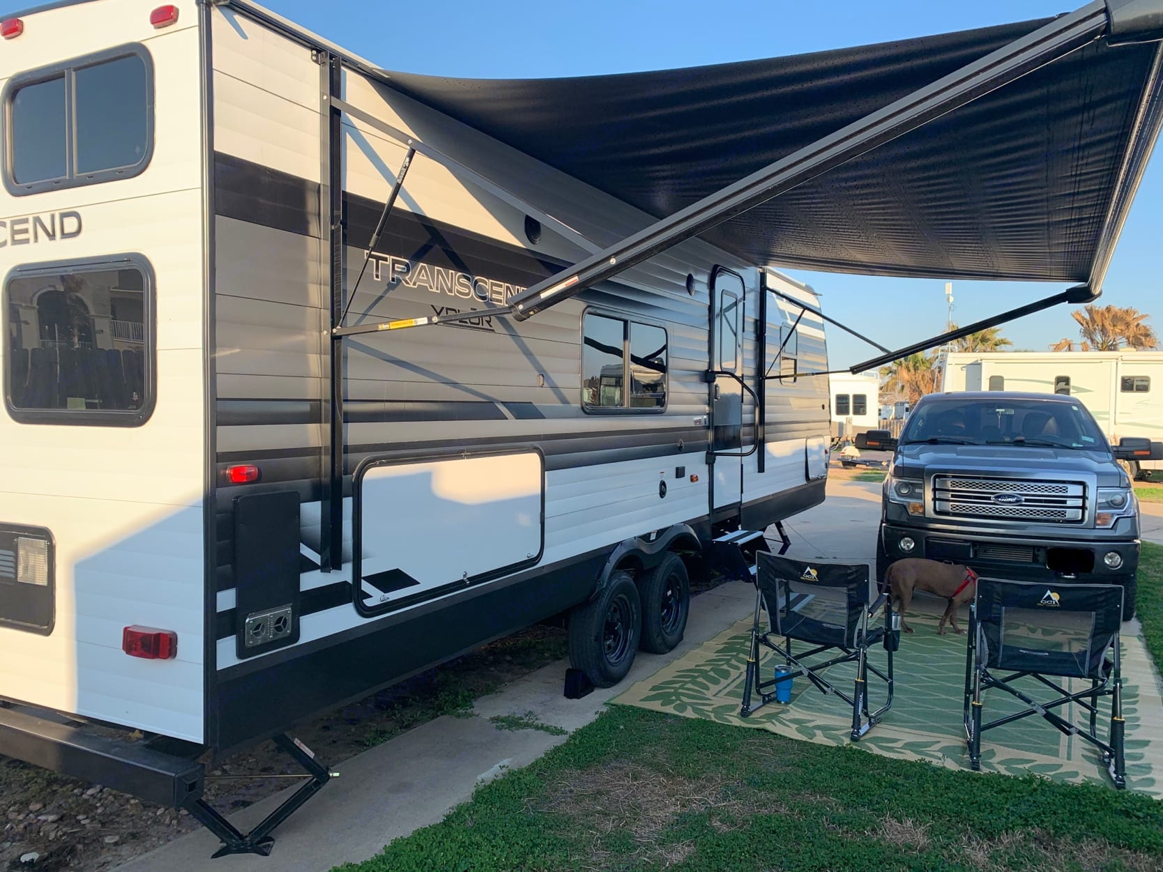 Owner setting up at their campsite in Port A!. Grand Design Transcend Xplor 2021