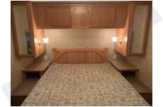 Plenty of closets for hanging clothes and storage above bed.  Wall outlets on each side for charging phones or other night time items.  . Crossroads Zinger 2006