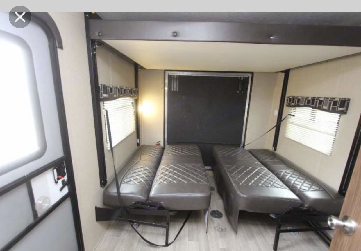 garage with two sofas and queen upper bed. Coleman Lantern 300 TQ 2018
