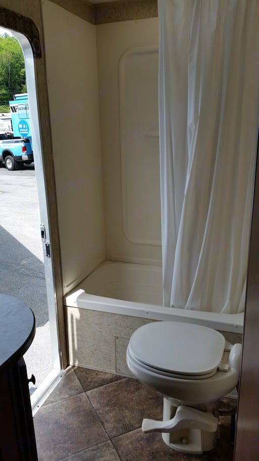 The shower is pretty great and roomy for a camper. The outside door provides easy access for when you are out at the fire and nature calls.. Heartland Prowler 2014