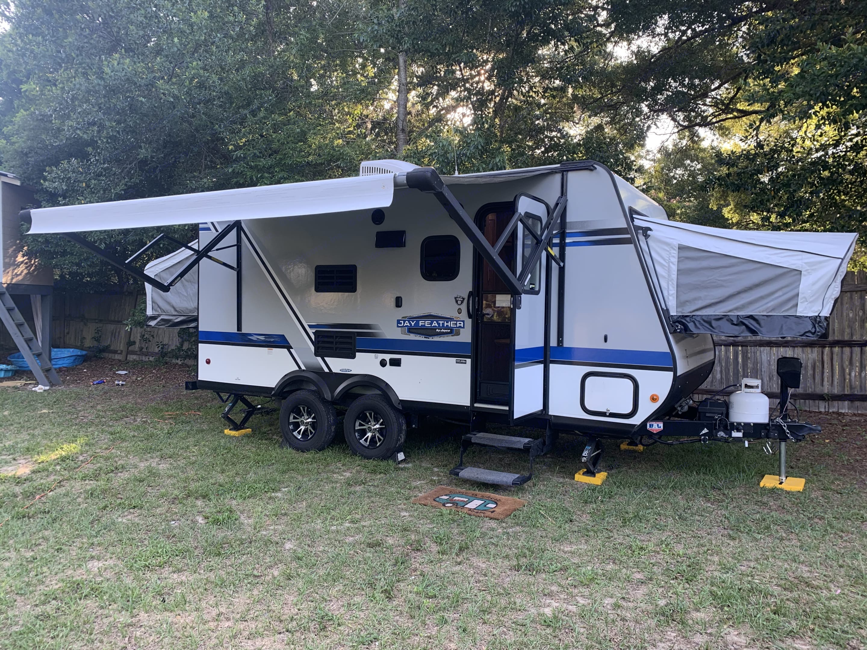 Exterior showing off two of the three fold out queen beds. Other one is located in the back. . Jayco Jay Feather 2019