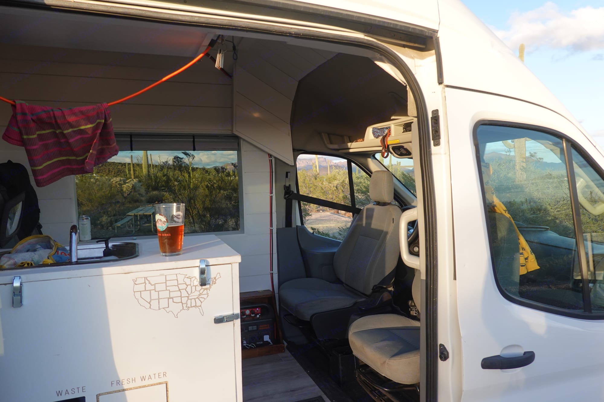 You can spin the two front seats when you are stationary and enjoy a drink and the sunset!. Ford Transit 2016