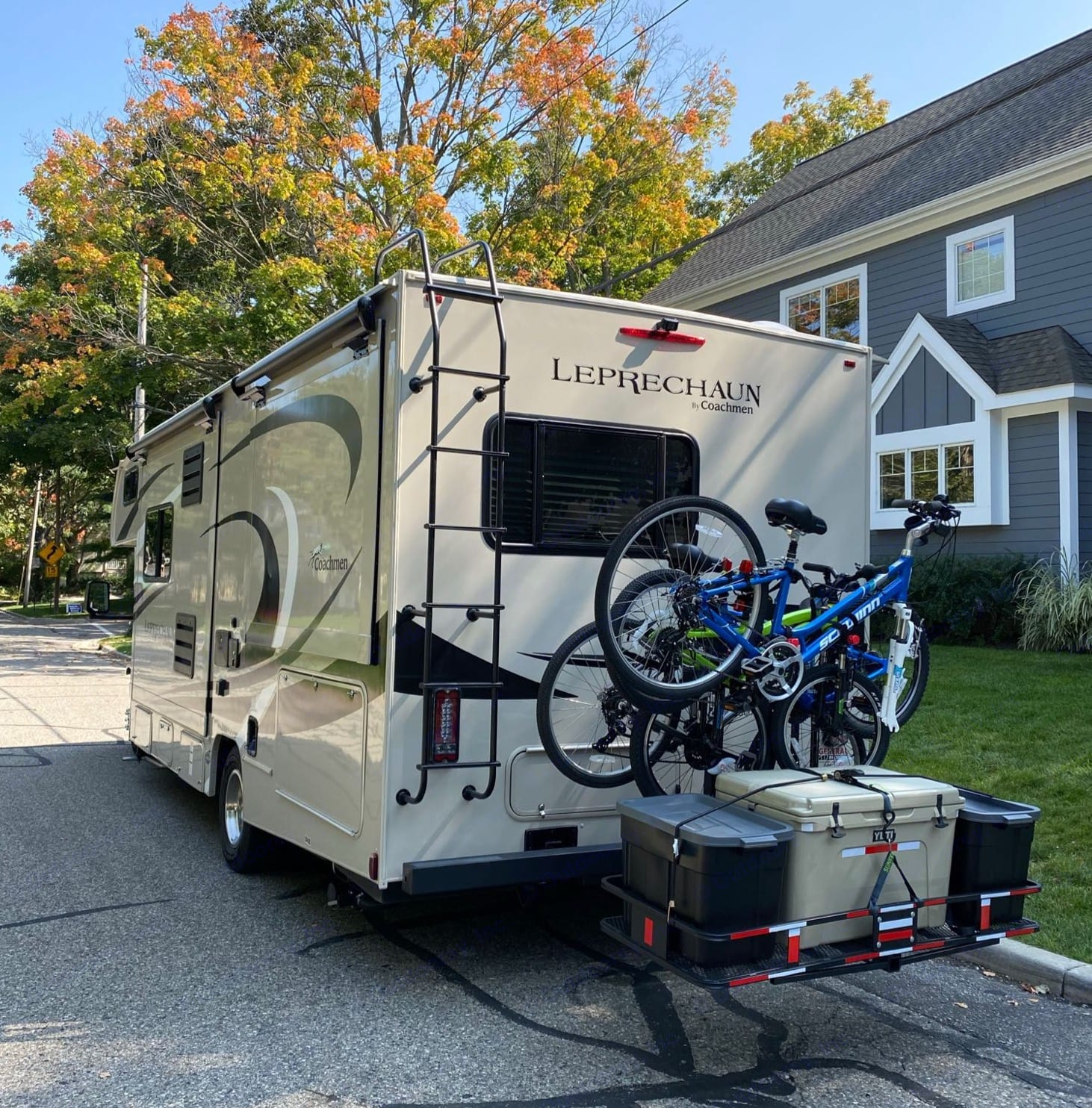 Ready to roll.  Bike Rack and Cargo Carrier fully loaded.. Coachmen Leprechaun 2021