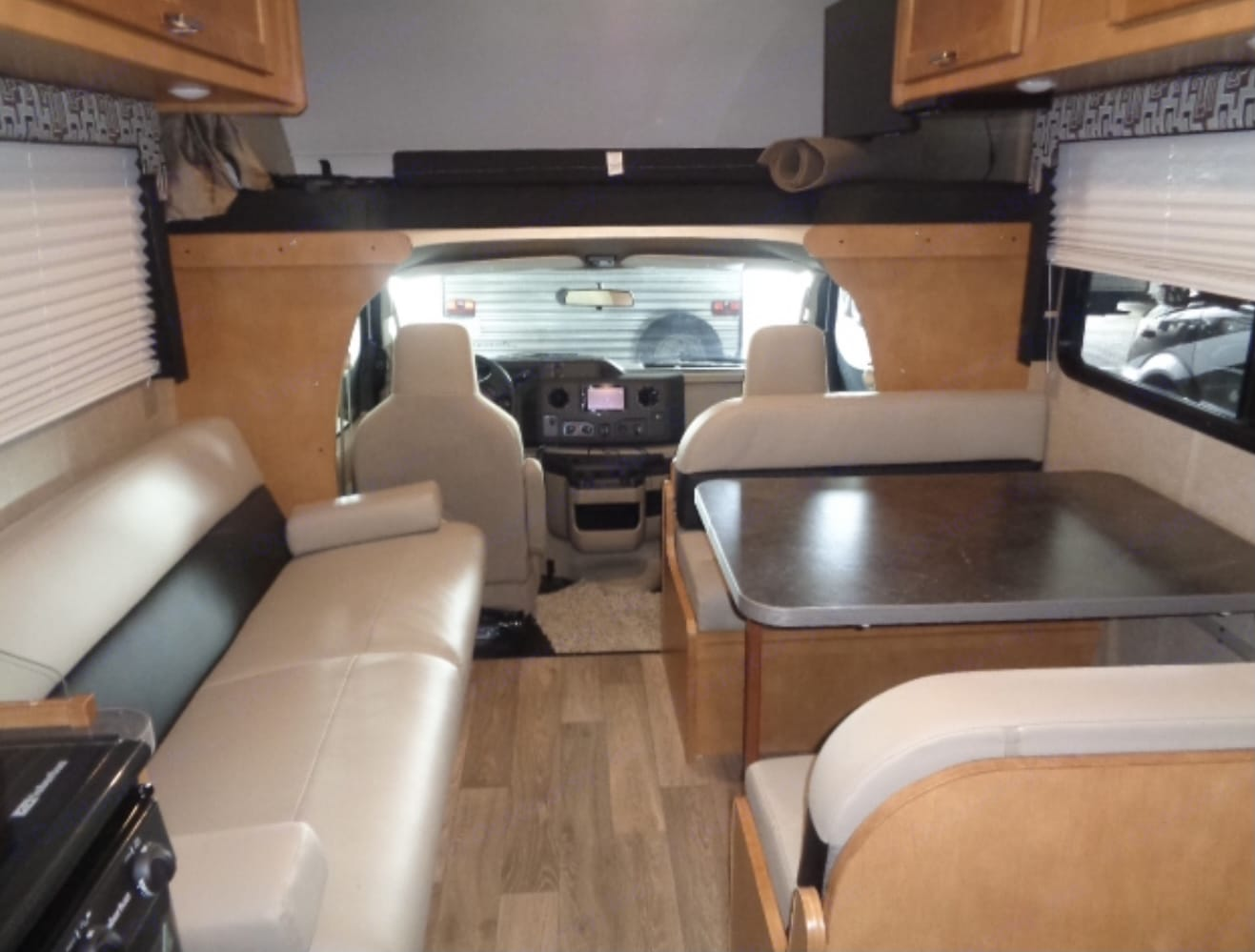 Jackknife couch pullout, dinette bed conversion, overhead cab bed to front queen bed to back. Winnebago Minnie Winnie 2019