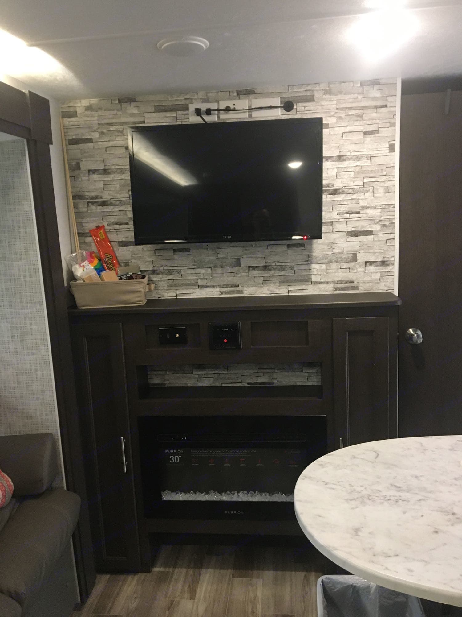 Entertainment Center with complimentary s'more basket.. Forest River Salem Cruise Lite 2019