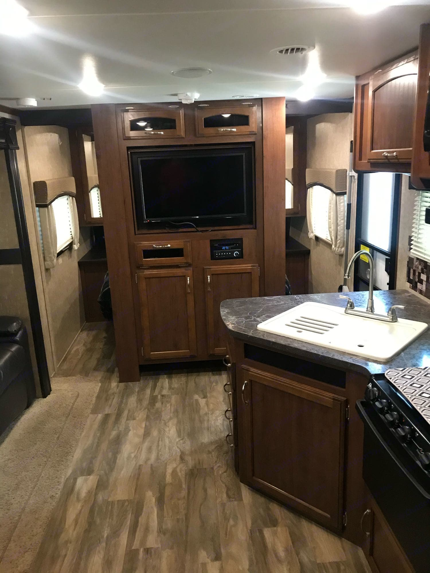 Entertainment center, pocket doors to either side for privacy in main bedroom. Jayco Jay Feather 2017