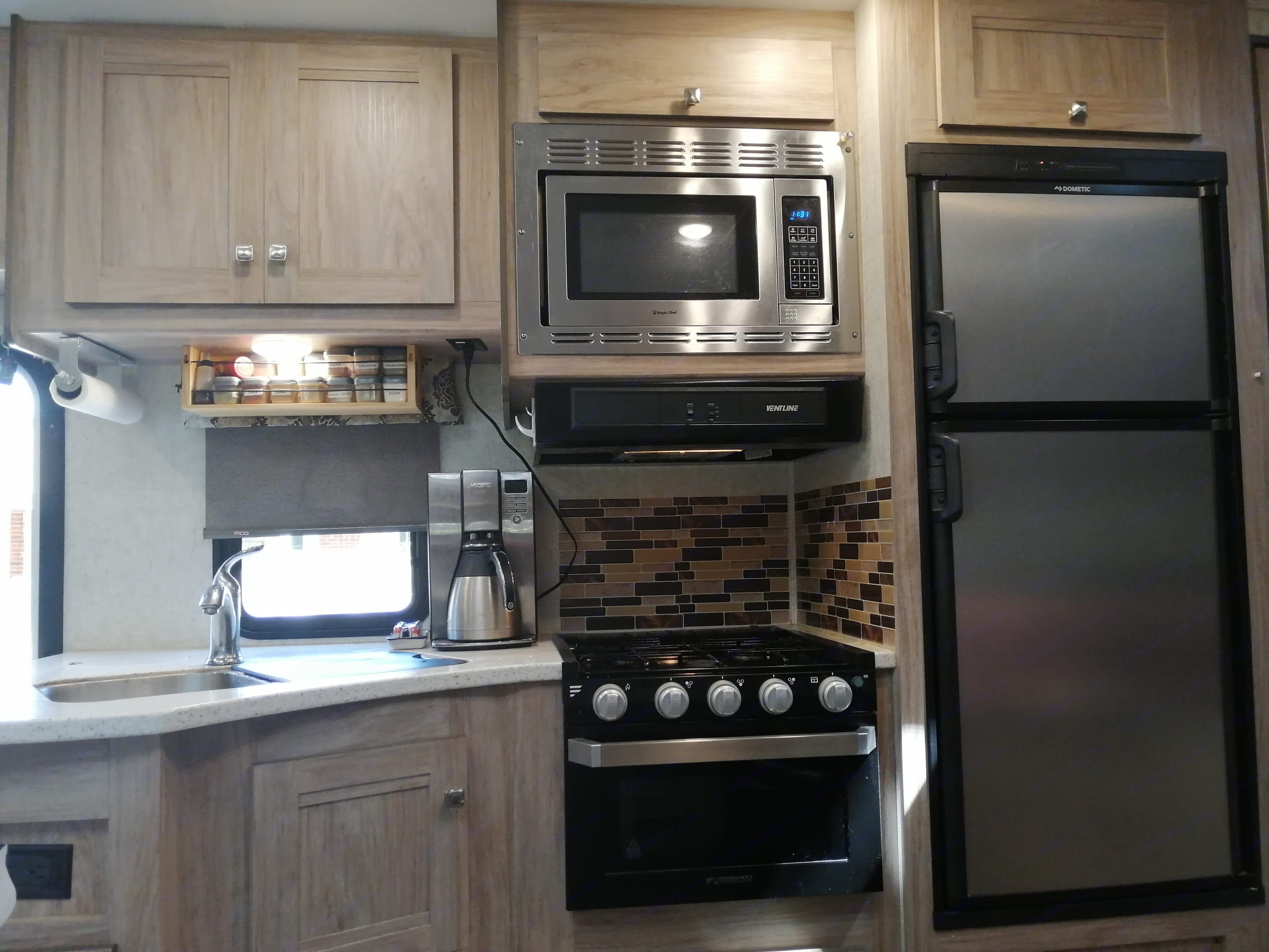 3 burner propane stove and propane oven. Lots of kitchen storage. . Forest River Forester 2020