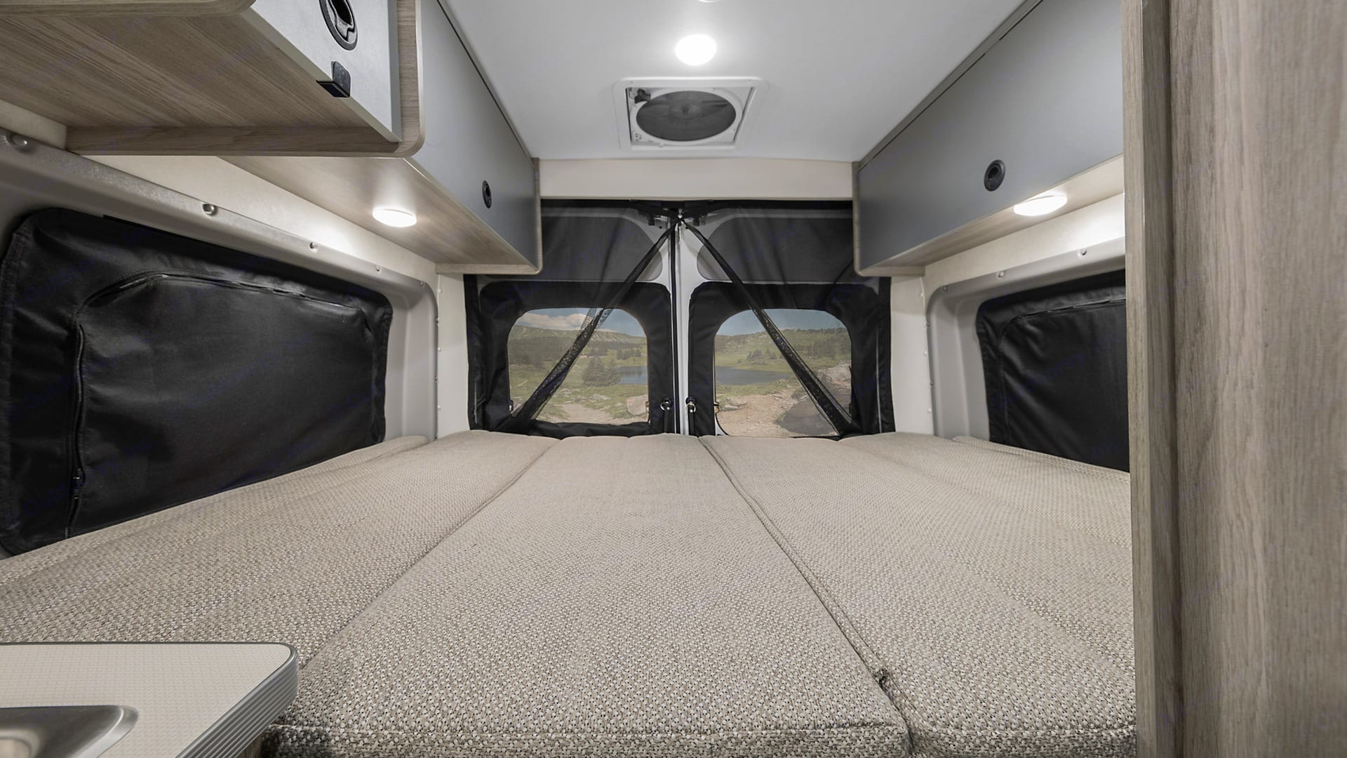 """Queen sized bed at the back of the van. I am 6'3"""" and can stretch out. The mattress is amazingly comfortable . Winnebago Solis 2020"""