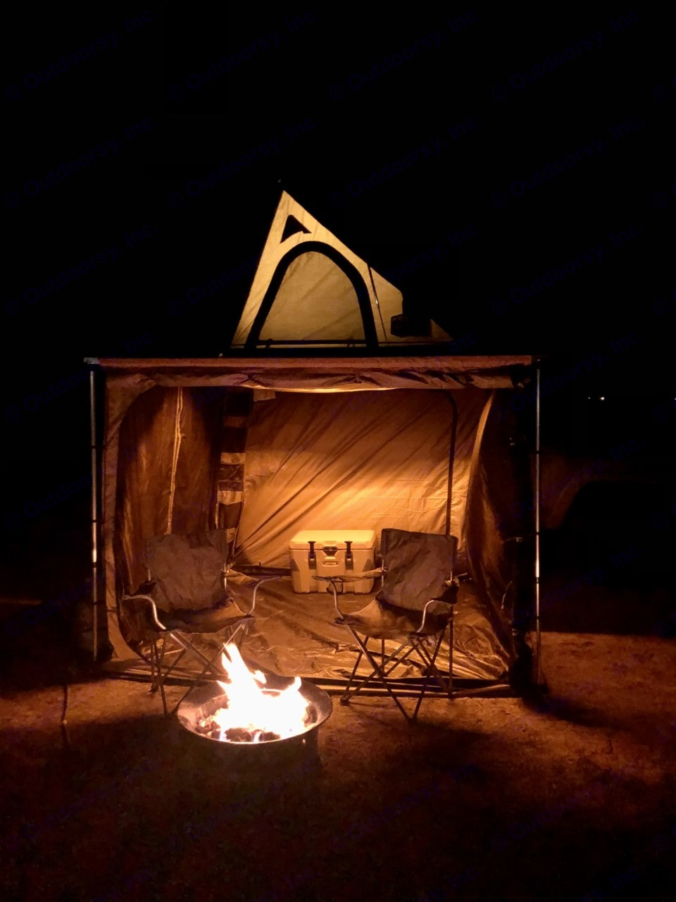 Cozy lighted awning lights for a memorable night by the fire. . Custom Camper 2021