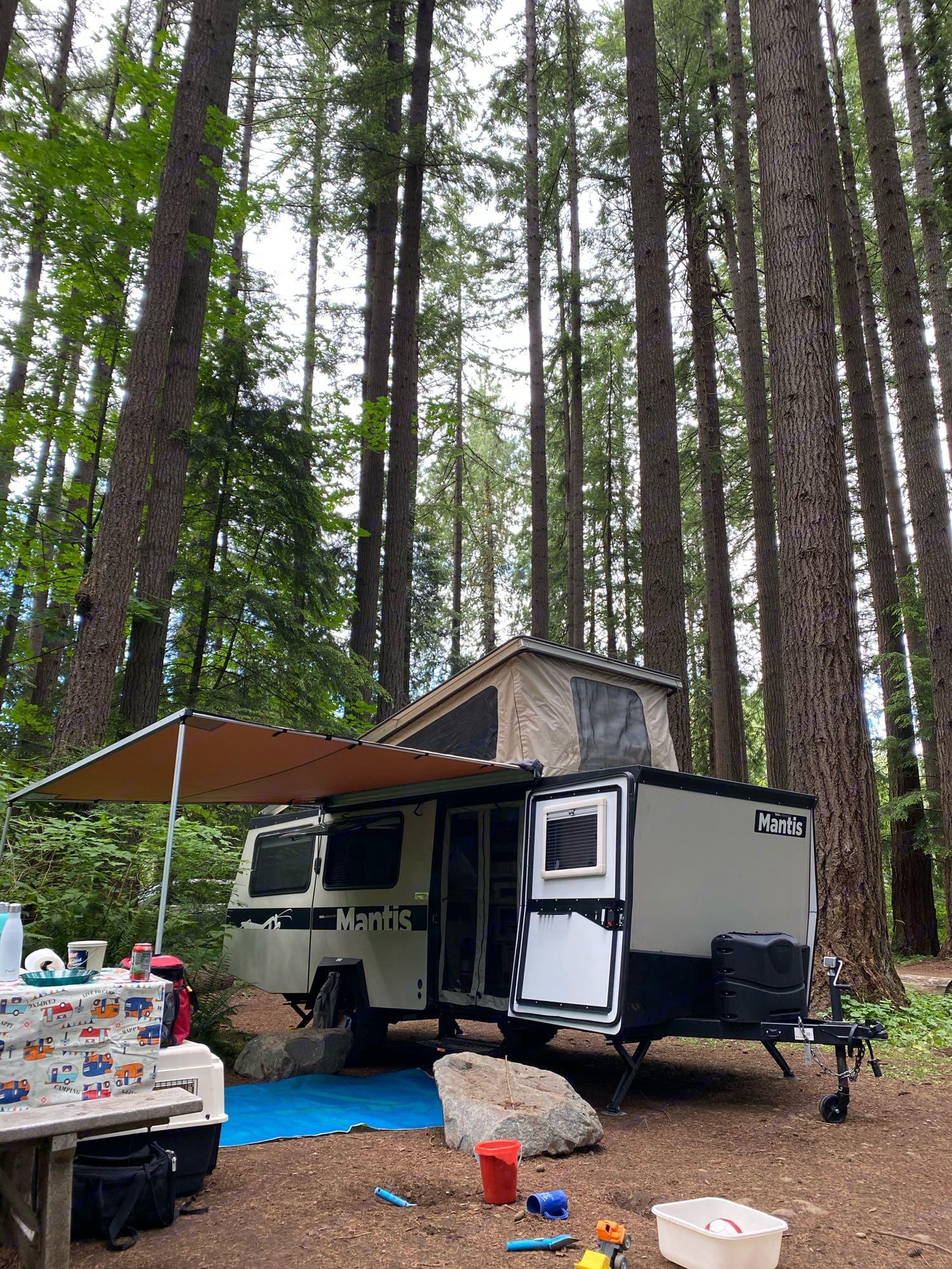 Setup with awning. TAXA Outdoors Mantis Camper 2019