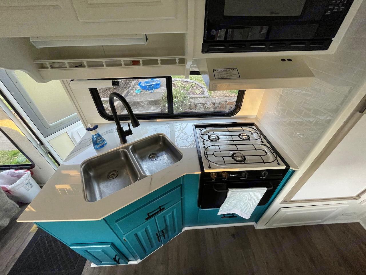 Ceramic countertop with new faucet, kitchen hardware, and paint. . Coachmen Santara 2001