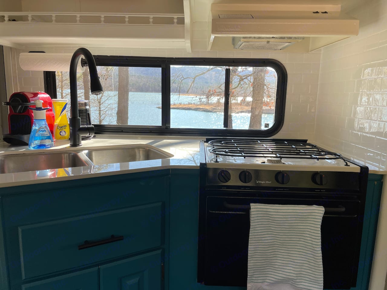 View of the lake from renovated kitchen, showing the Nespresso coffee machine.. Coachmen Santara 2001