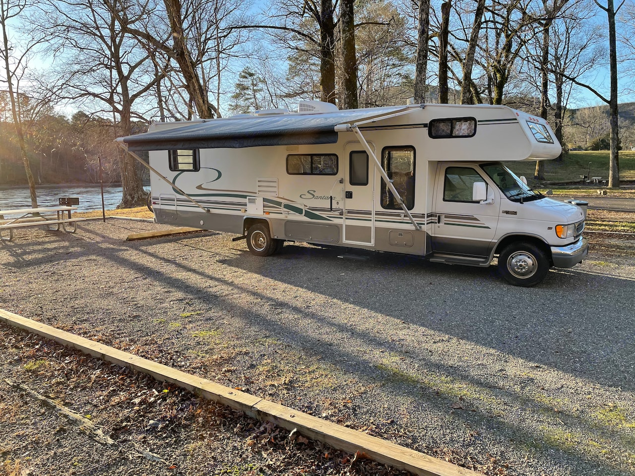 Our trip to Hot Springs national park to go fishing, where our RV spread her wings at this beautiful riverside campground. Coachmen Santara 2001