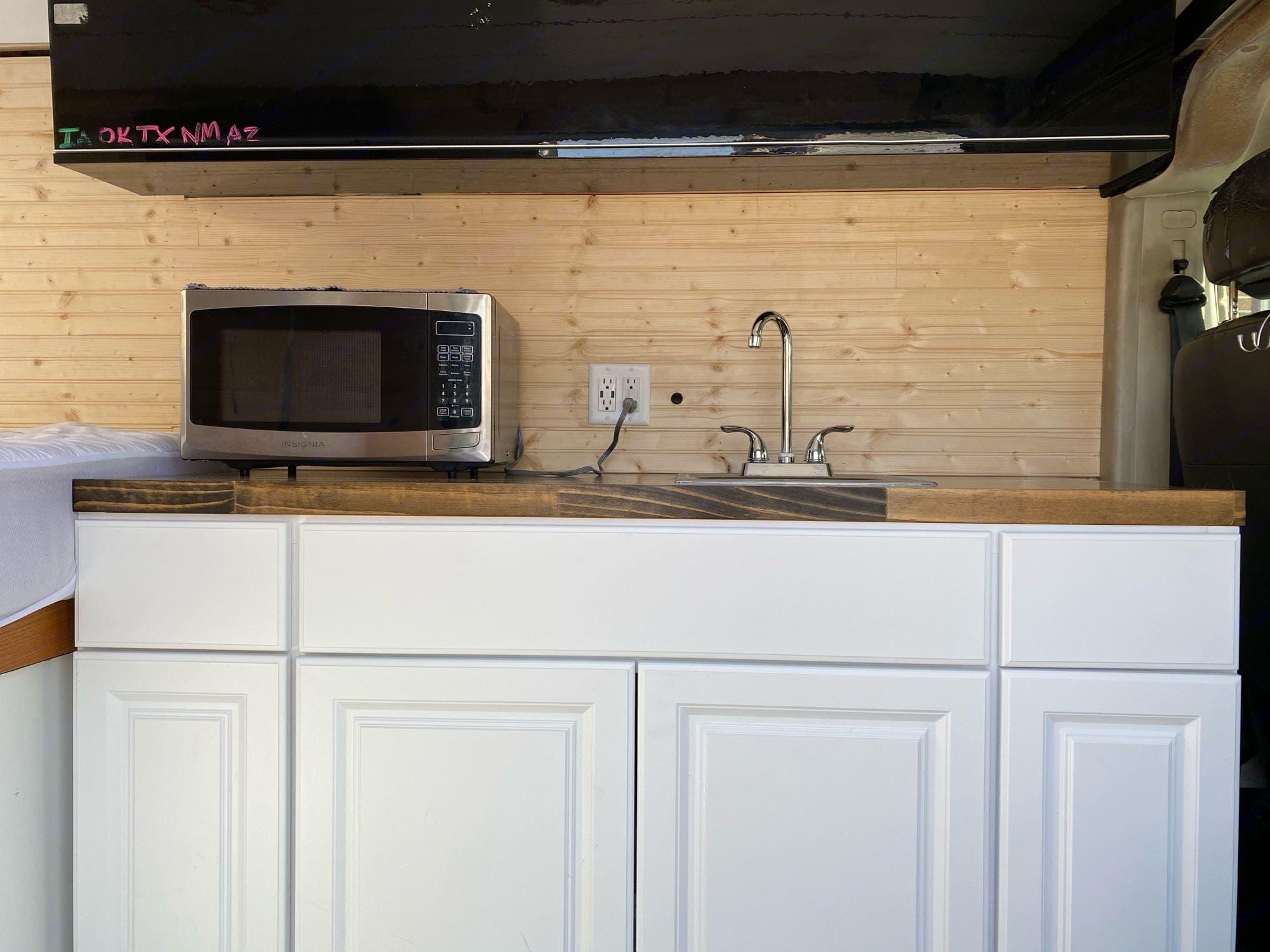 Kitchen, microwave, sink and storage. Dodge Ram 1500 2019
