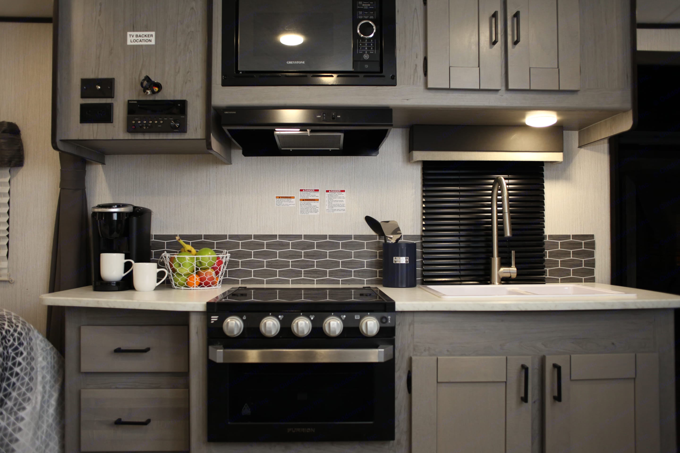 Microwave, oven , 3 burner stove. Rental includes a keurig machine (bring pods and creamer) 1 pot and 1 pan and some utensils included. Heartland Mallard 2020