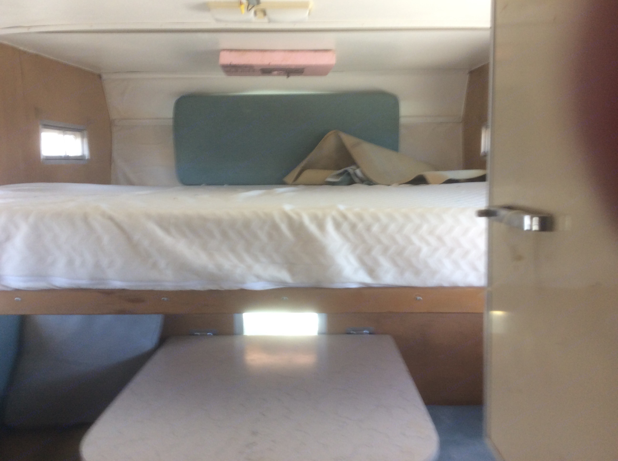 """Pull-out bed supports a queen sized 8"""" memory foam mattress. . Winnebago Ford F250 1964"""