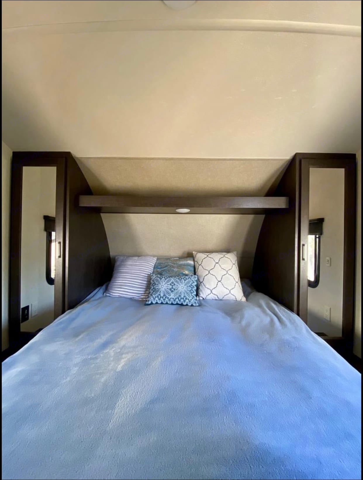 This room has walk around queen sized bed with upgraded memory foam. There is a reading light and plenty of storage on each side of the bed. . Forest River Wildwood X-Lite 2018