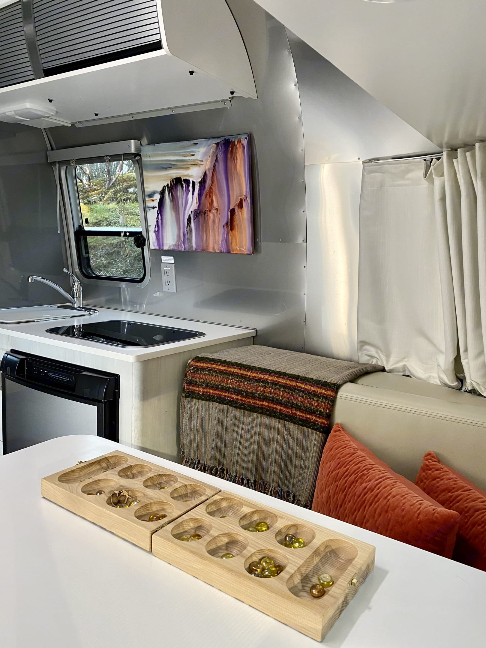 Time to chill in the Airstream after a day of exploring... books, mancala, journaling, scrabble, or maybe planning your next adventure?. Airstream Sport 2016