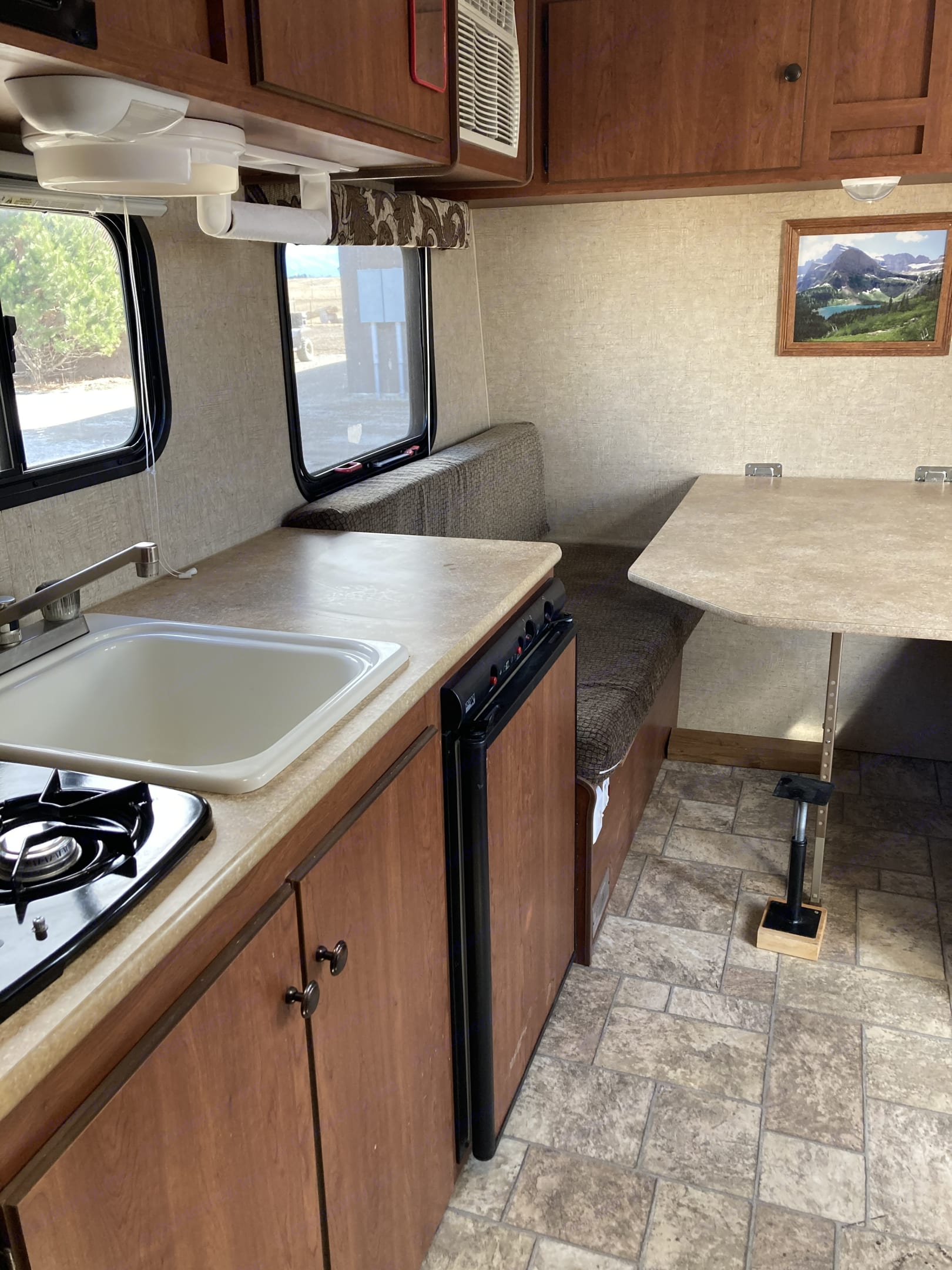 Kitchen and dining area/master bed. K-Z Manufacturing Sportsman Classic 2013