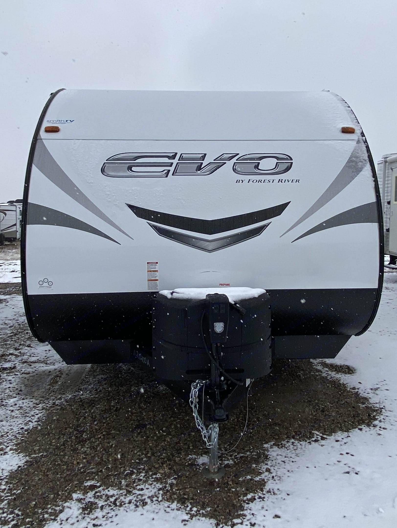Exterior front with enclosed heat tanks.. Forest River Evo 2021