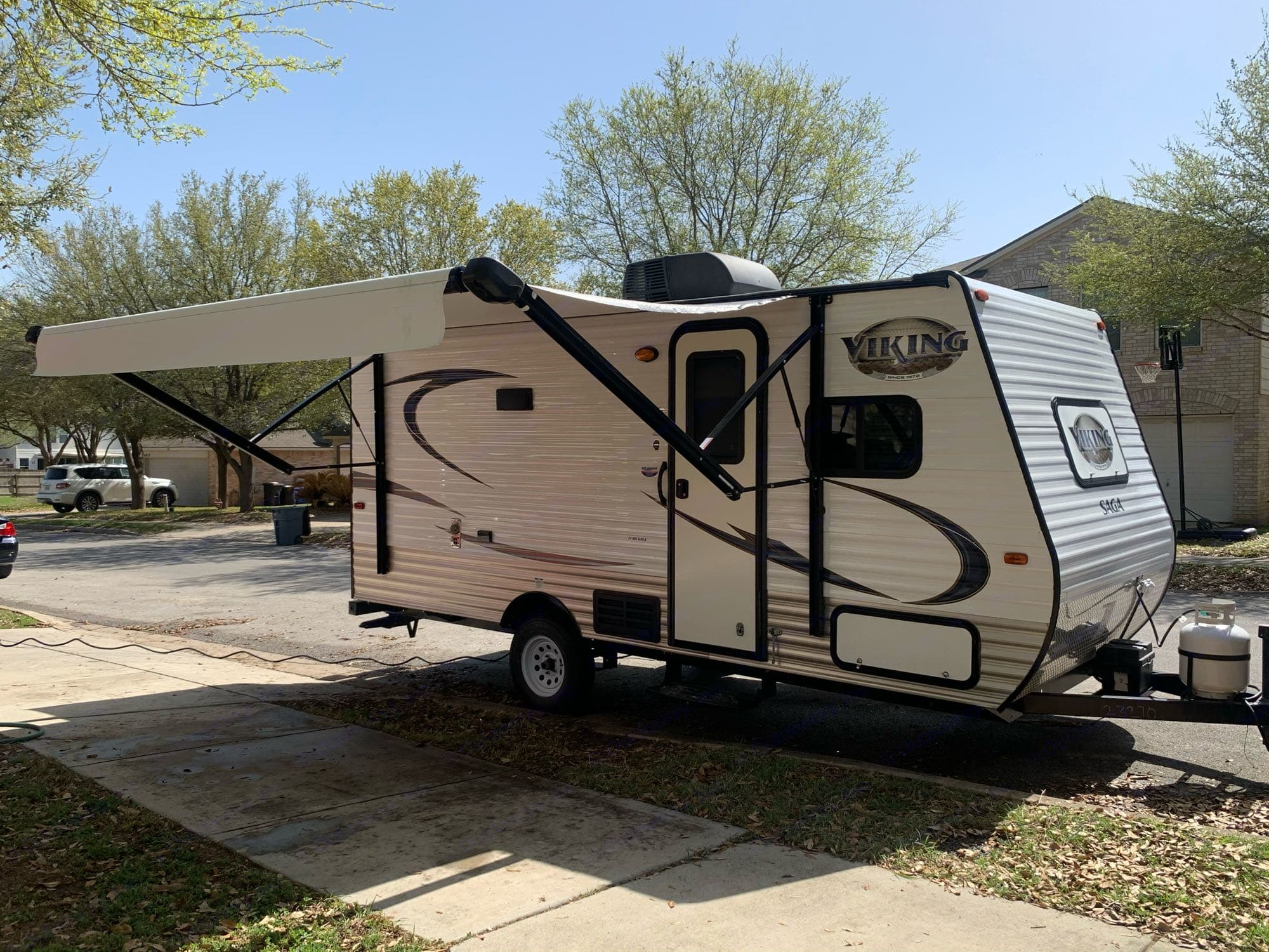 Curbside with power awning extended.. Forest River Viking 2018