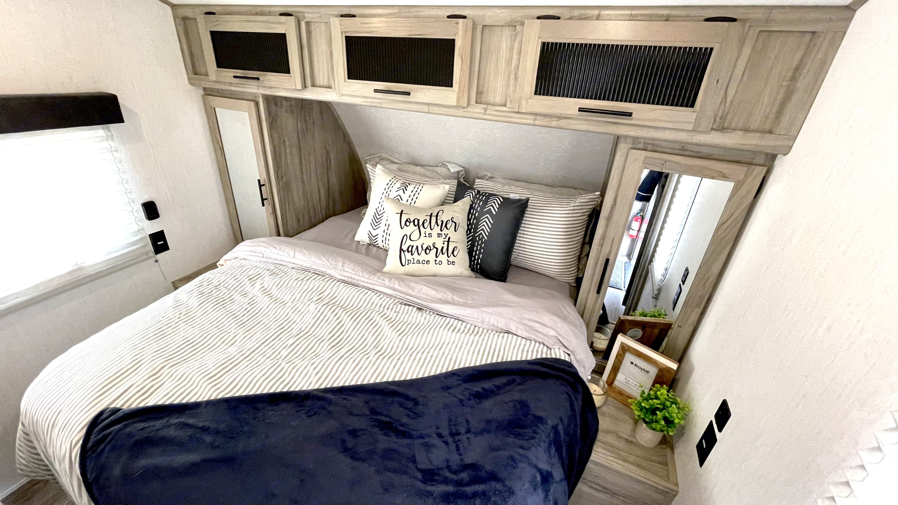 Queen size bed with 2 closets and 2 bedroom doors for easy access to both sides of the bed. Forest River Cherokee 2021