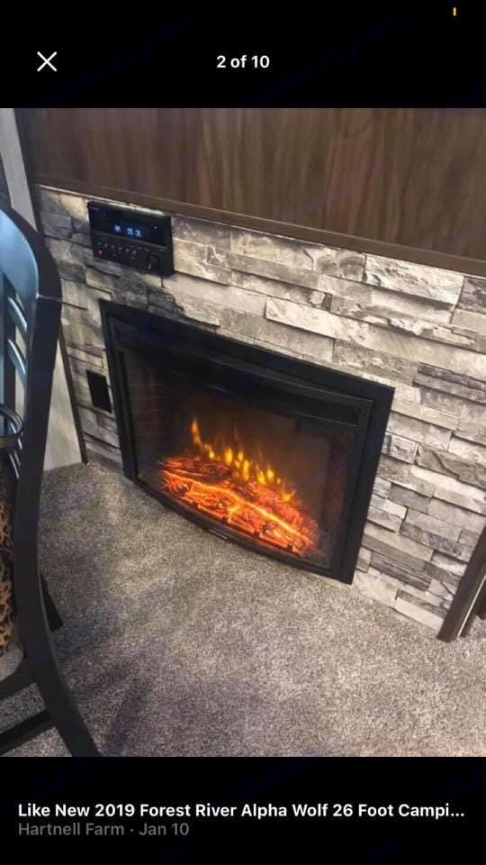 This fireplace does put off heat and There is a big screen tv above it along with a radio and a place for you to play your DVD. Forest River Cherokee 2019