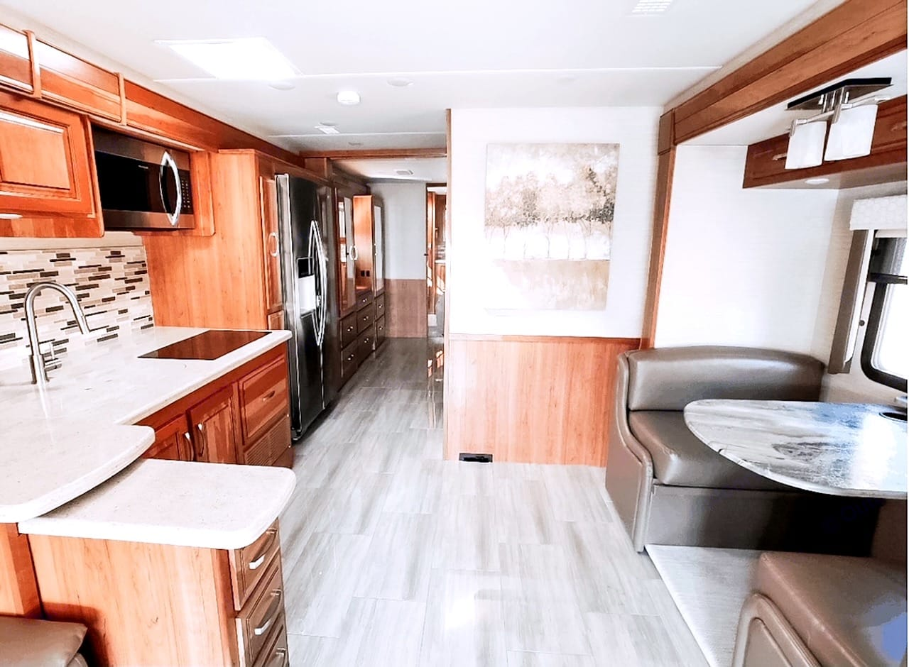 Configure the dining area to your liking. Counter slides in/out. Table collapses into a bed.. Entegra Coach Reatta 2019