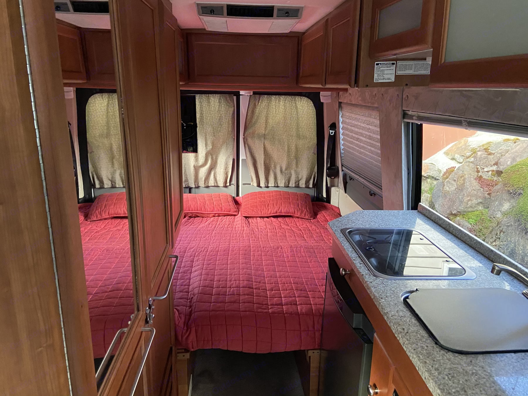 King Size Bed- Comfy, private and easy to set up, take down. (Tents, eat your heart out!). Roadtrek Sprinter Adventurous Rs 2012