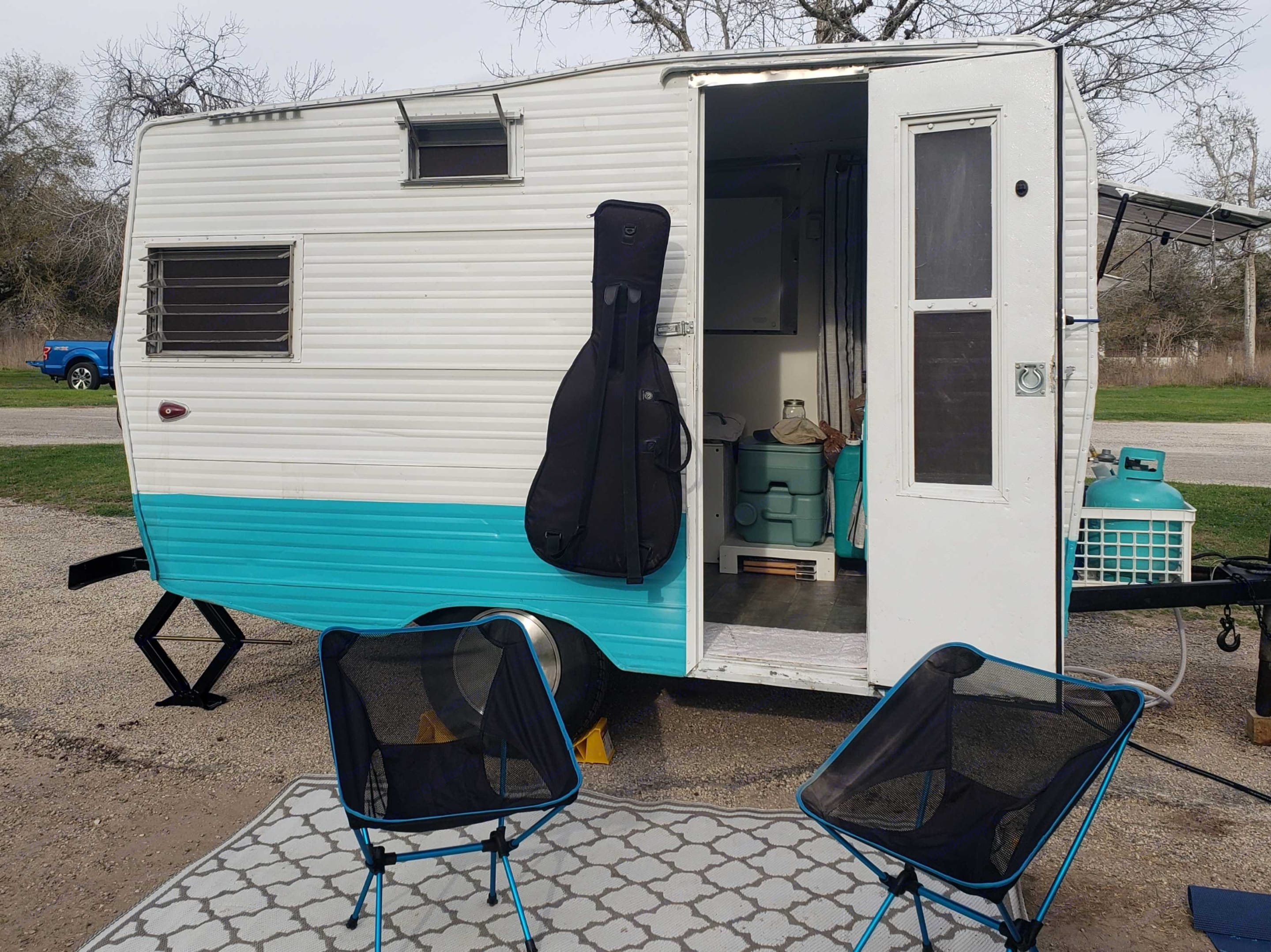 Set up as a breeze with an outdoor rug and 2 folding camp chairs included. Bring your guitar, or connect your phone to the Bluetooth speaker provided.. Aristocrat Lo-Liner 1963