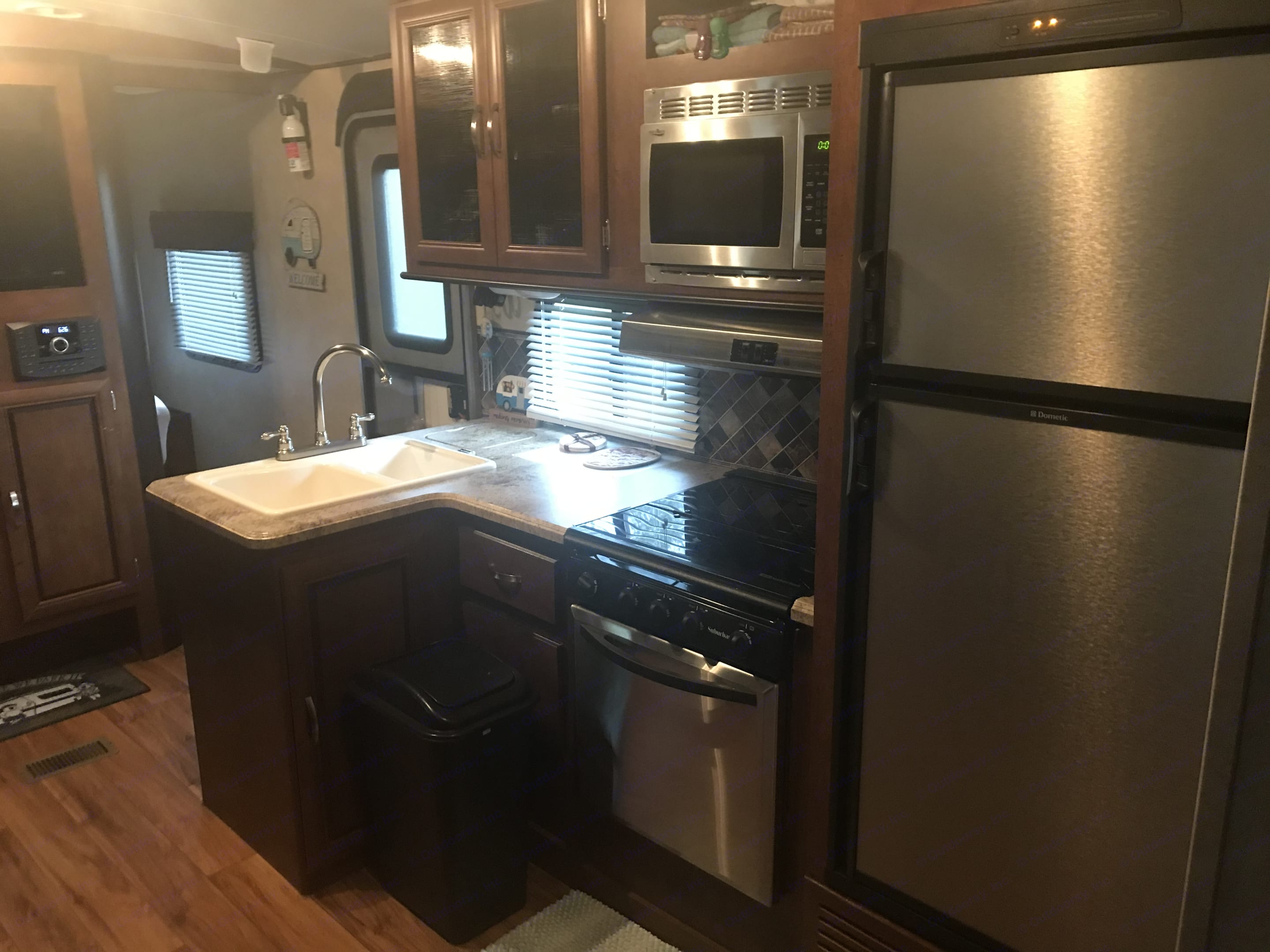 Gas/Electric fridge and freezer, gas stove and oven, Elec microwave. Forest River Vibe 2016