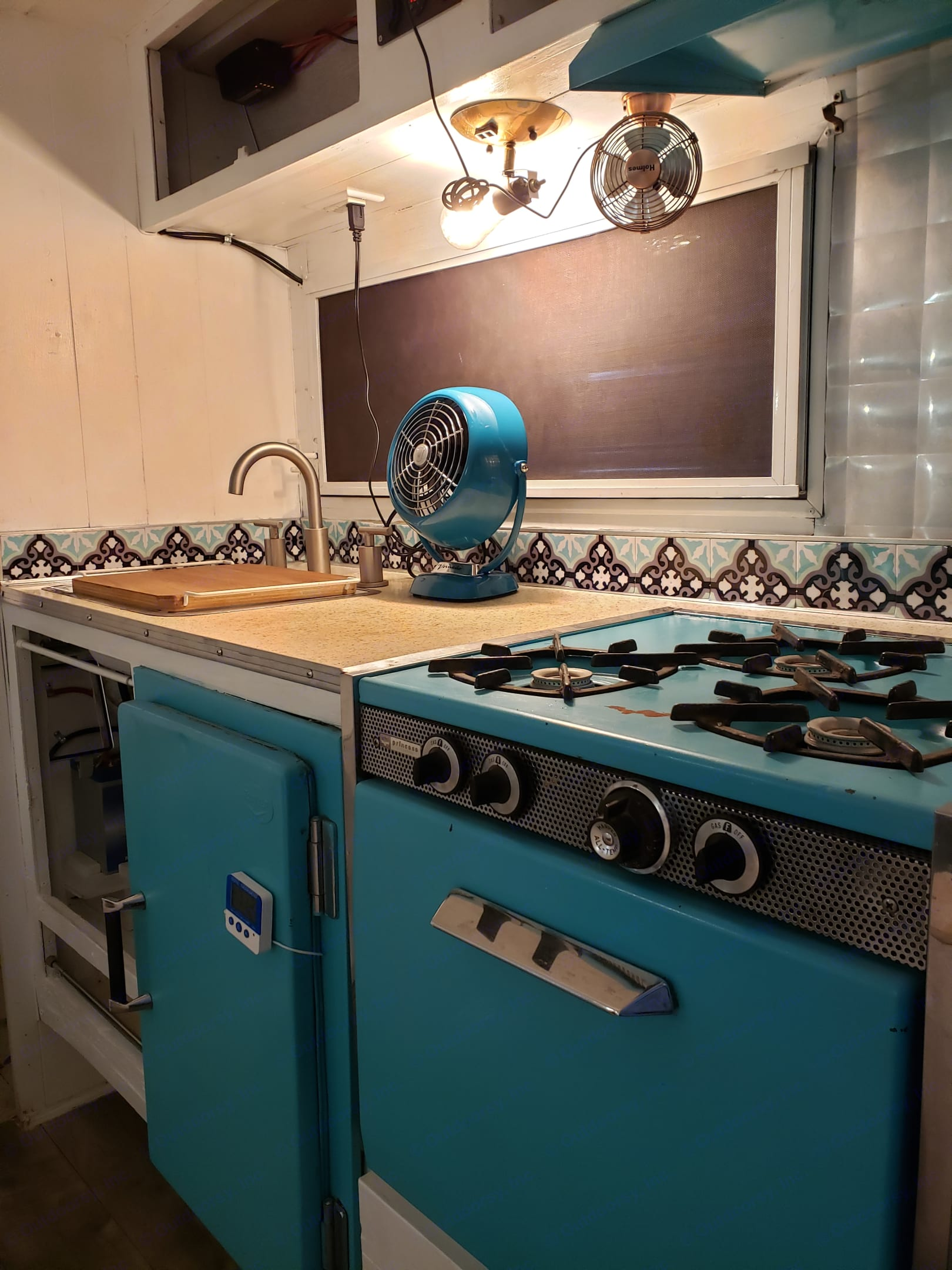 Fully functional kitchen with hot and cold water, gas range, under cabinet lighting, vent fan, and original icebox!. Aristocrat Lo-Liner 1963