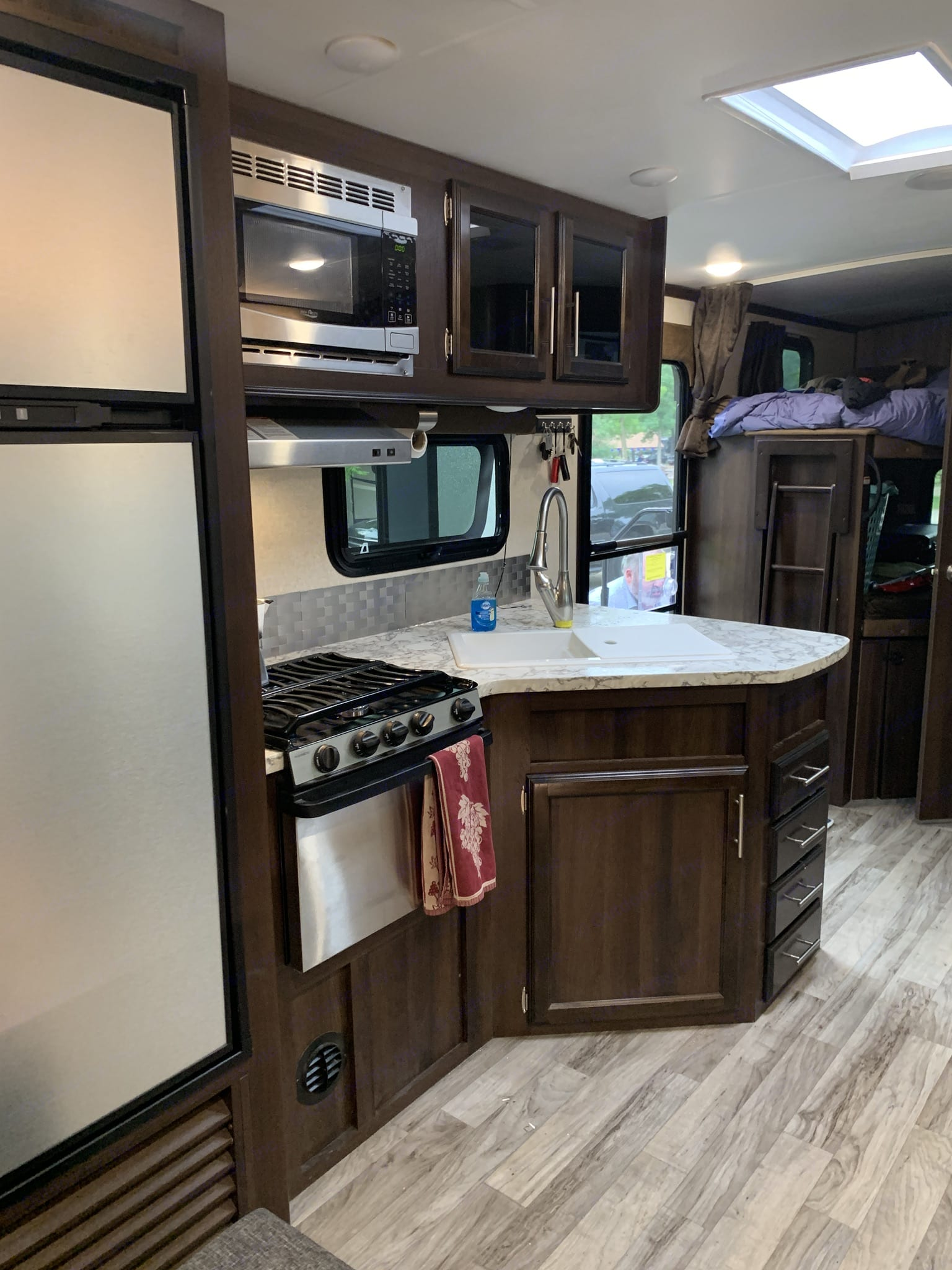 Kitchen with double sink, 3 burner stove, microwave and good size fridge. Jayco White Hawk 29Bh 2018