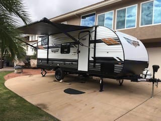 Very light and easy to pull.  It has a full power awning.. Forest River Wildwood X-Lite 2021