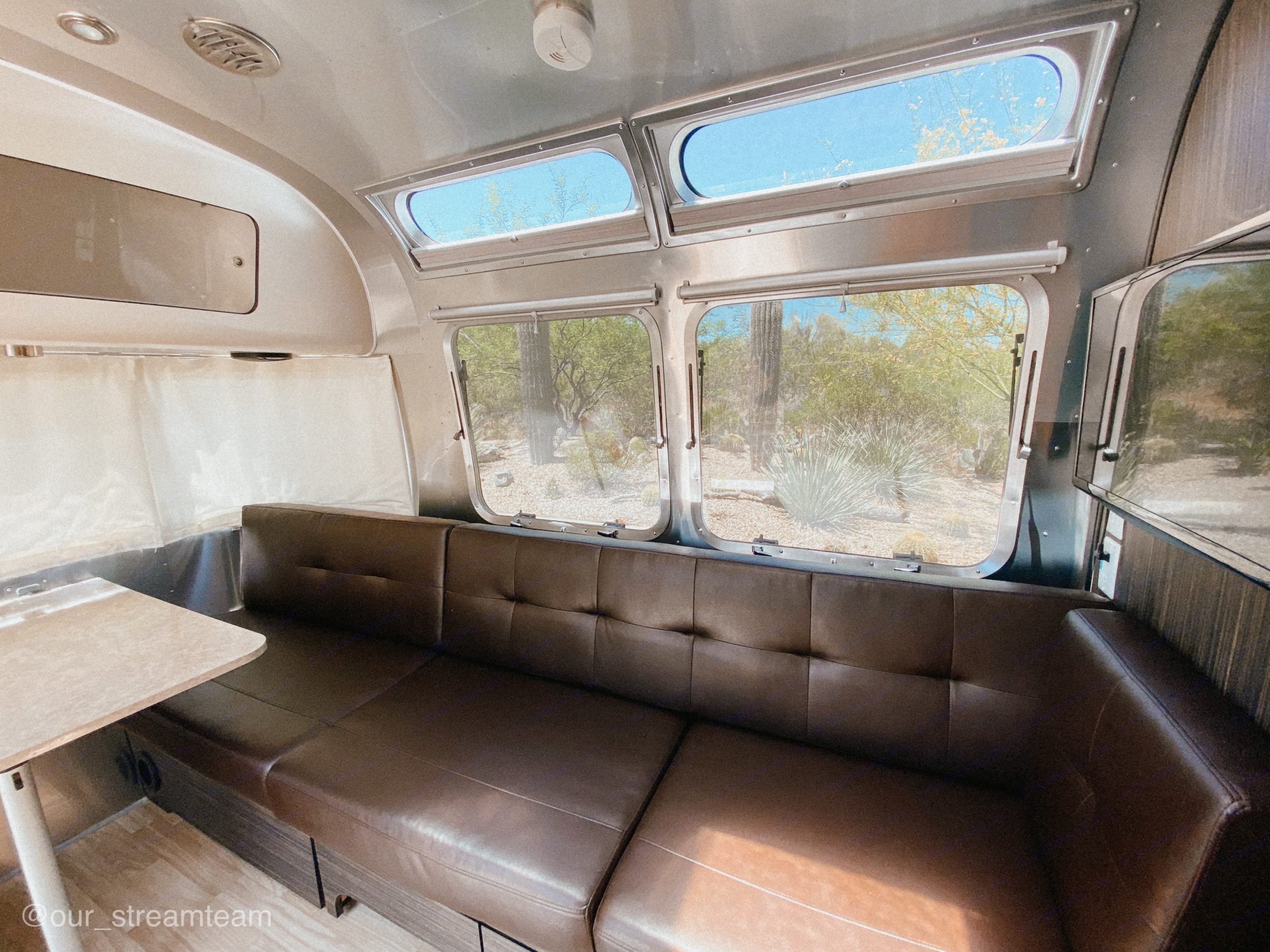 Pull out couch to bed with TV. Airstream International 2015