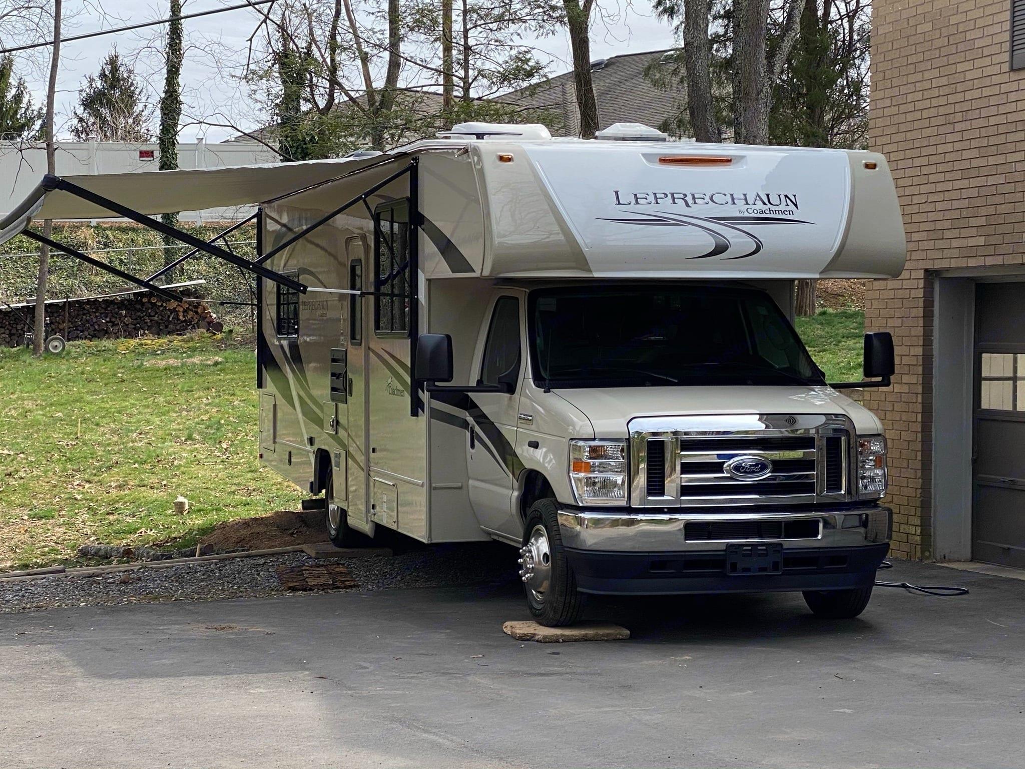 RV Leprechaun with awning out.. Coachmen Leprechaun 2021