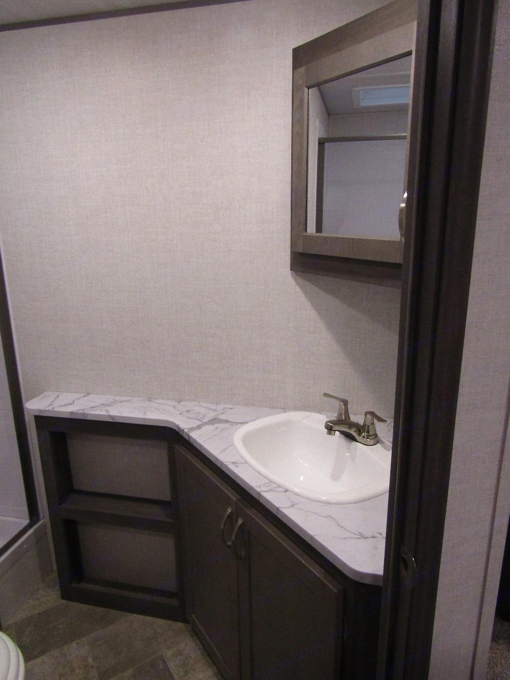 Bathroom sink and vanity.. Forest River East to West Ala 2800KBH 2021