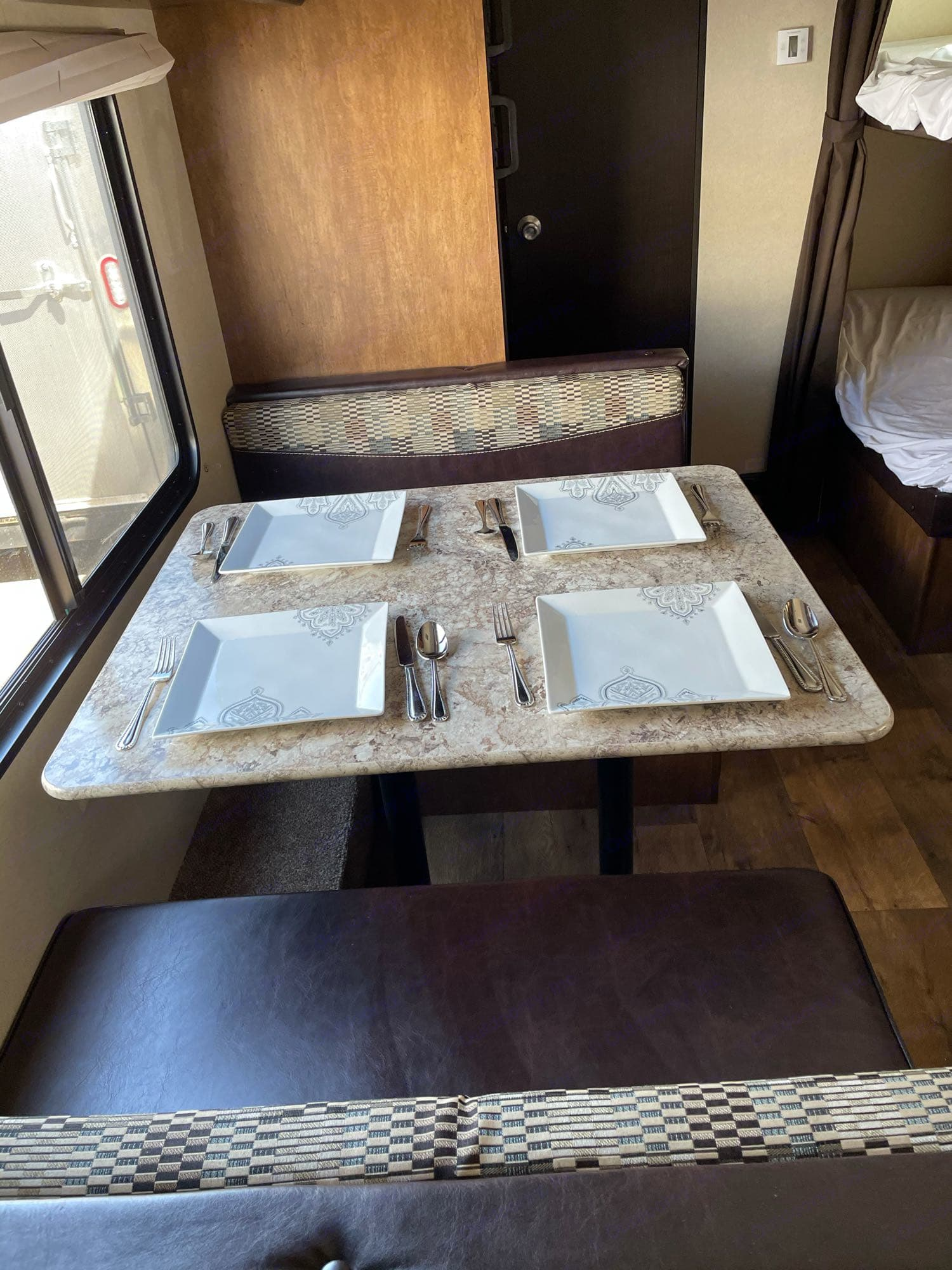 Dinette easily seats 4 adults. Forest River Wildwood X-Lite 2018