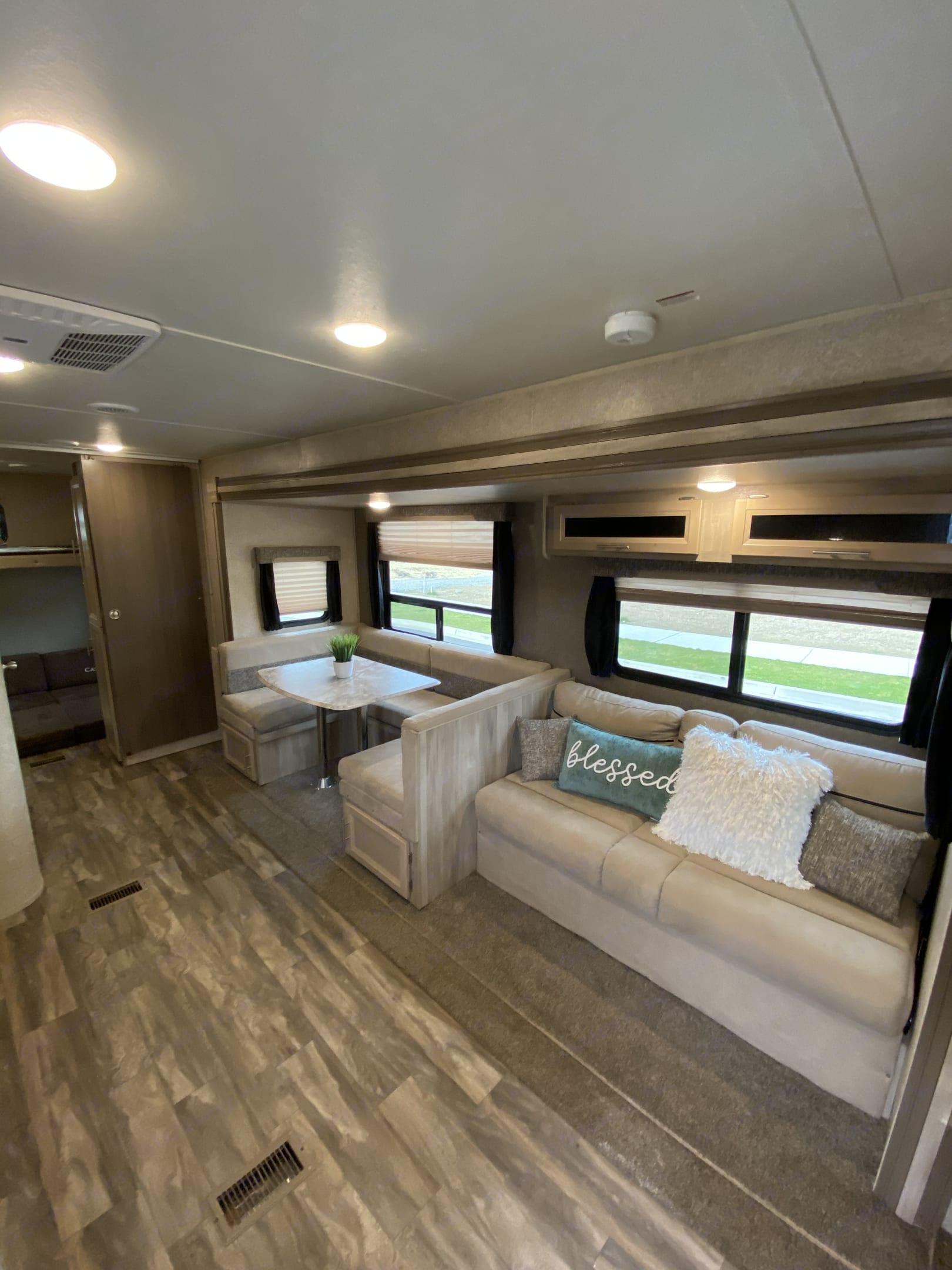 Comfortable dining area and extendable sofa. Coachmen Catalina 2019