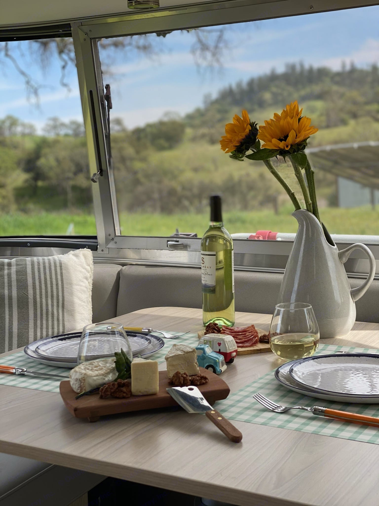 The Unruly Puli has wraparound Windows in the dining area and the bedroom. Enjoy the dinette with a cheese plate and a glass of wine!. Airstream Globetrotter 2019
