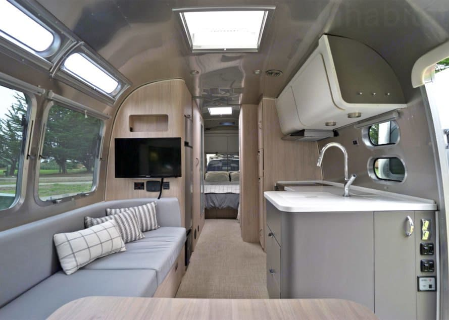 View from the dinette to the bedroom - the length of the 27 foot Unruly Puli. Airstream Globetrotter 2019