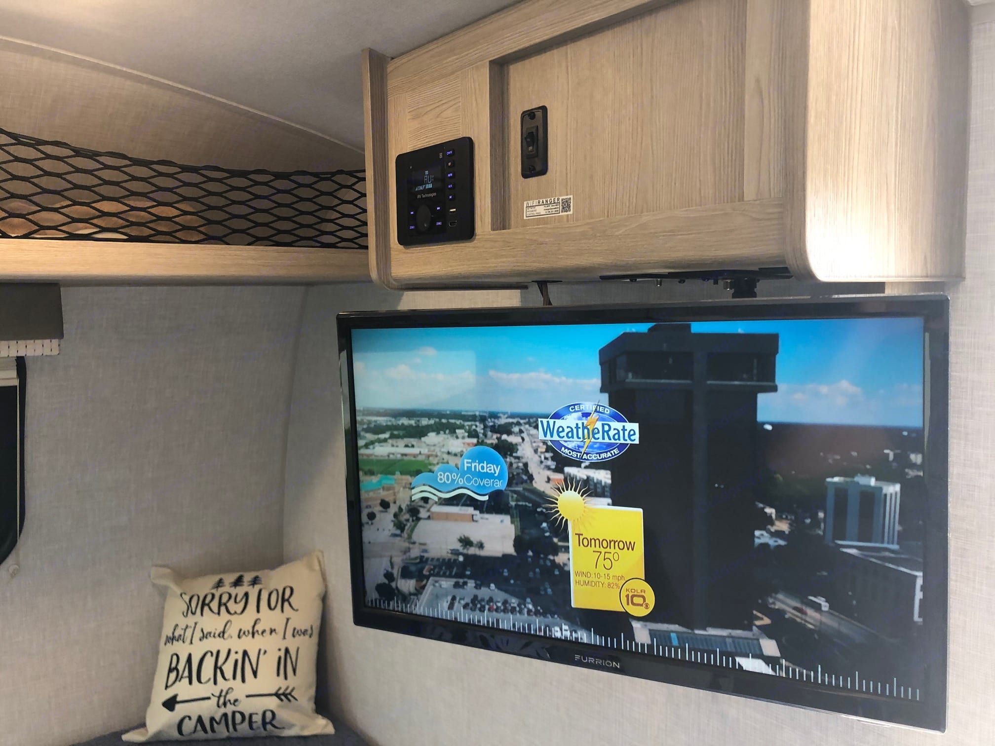 TV is 12 volt, so you can boondock with it if you like and run from solar. It also has a DVD player. Runs on regular electrical plugin as well.. Forest River Rockwood 2021