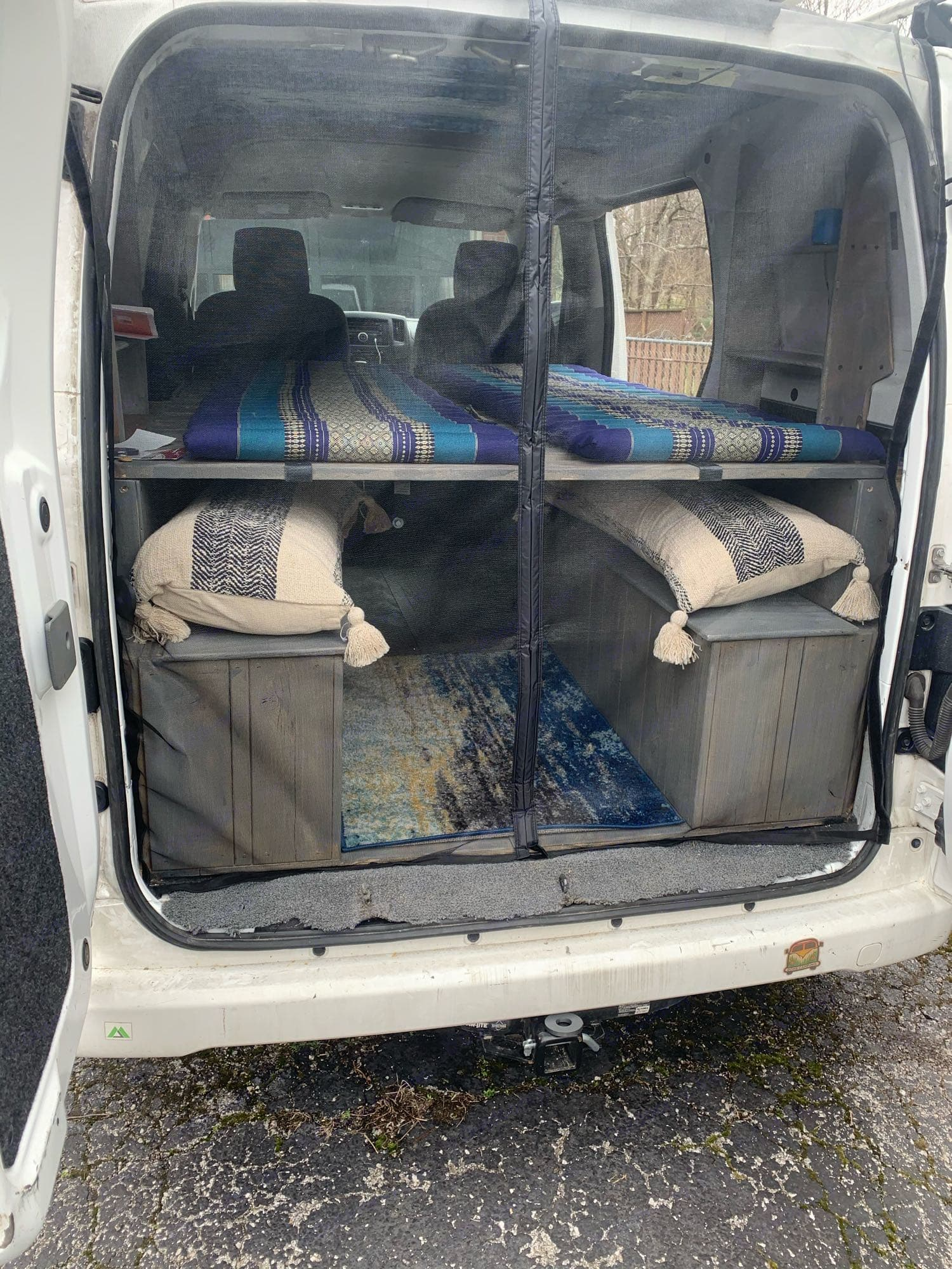 Bed slats fold out of the way to utilize the benches.. Nissan NV200 2015