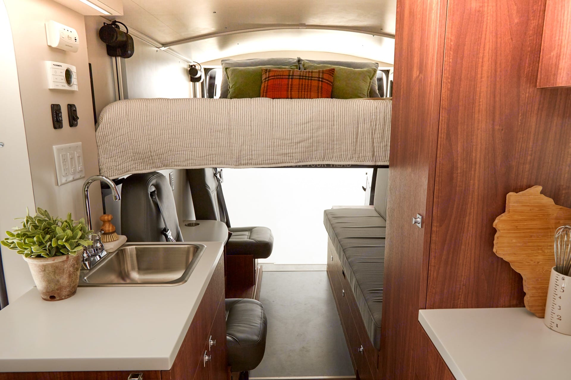 Powered camper size queen bed in lowered position. (Props not included) . RAM Promaster 3500 2020