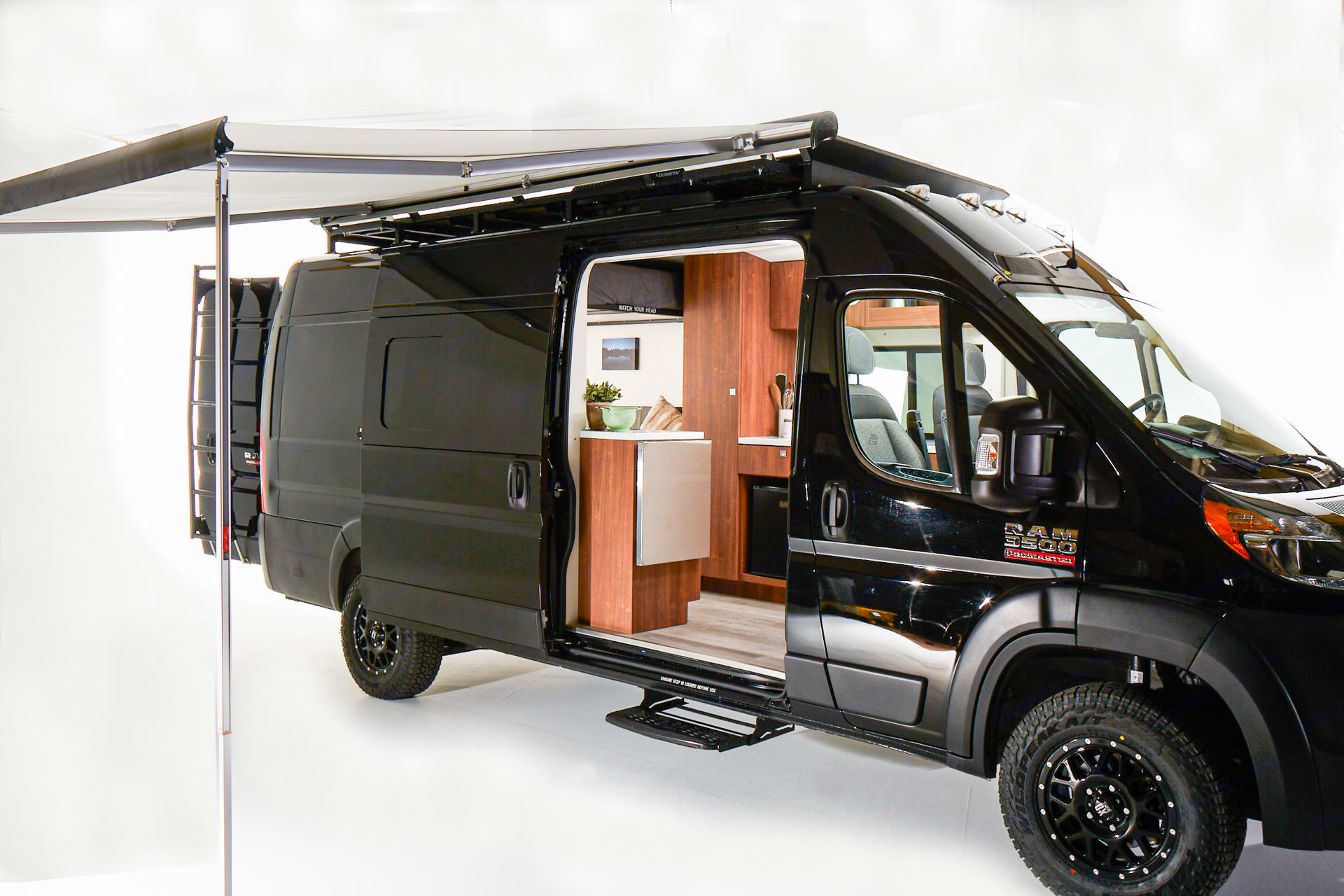 Powered awning and side door open. Interior lighting is on. (Props not included). RAM Promaster 3500 2020