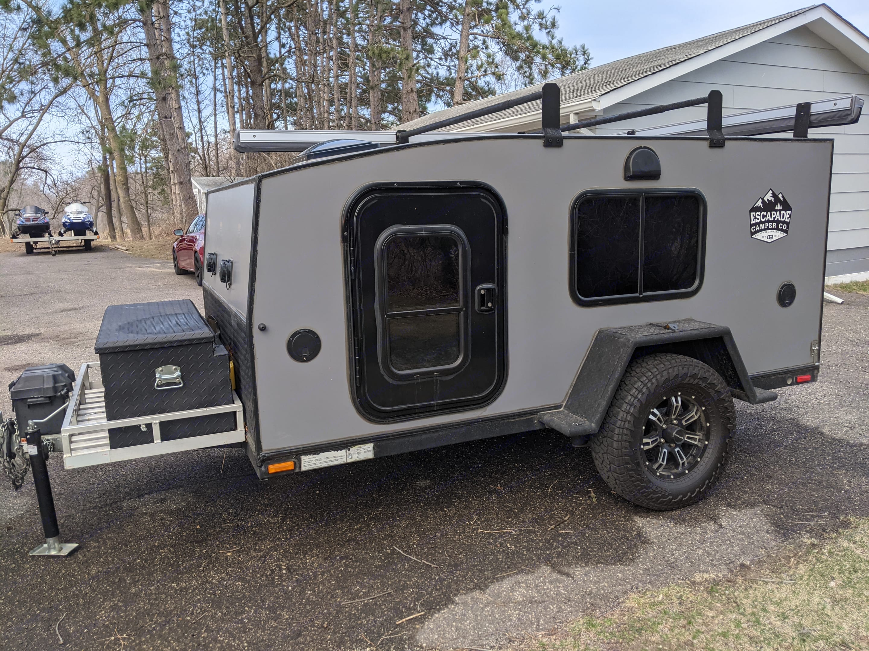 """Camper has 16in. ground clearance with """"Timbren"""" axle-less suspension. Aluminum wheels wrapped in Falken Wildpeak tires. Step fenders. 2"""" ball.. 2018"""